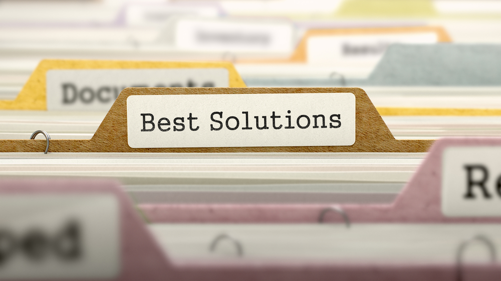 "Labeled file folders with a focus on a file titled ""Best Solutions"""