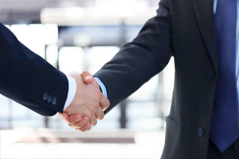 Image of Two Business Colleagues Shaking Hands
