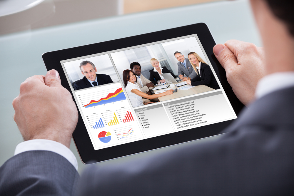 Image of a Business Owner Reviewing Information on Management and Key Employees on a Tablet