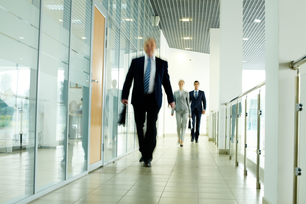 Business man exiting a building