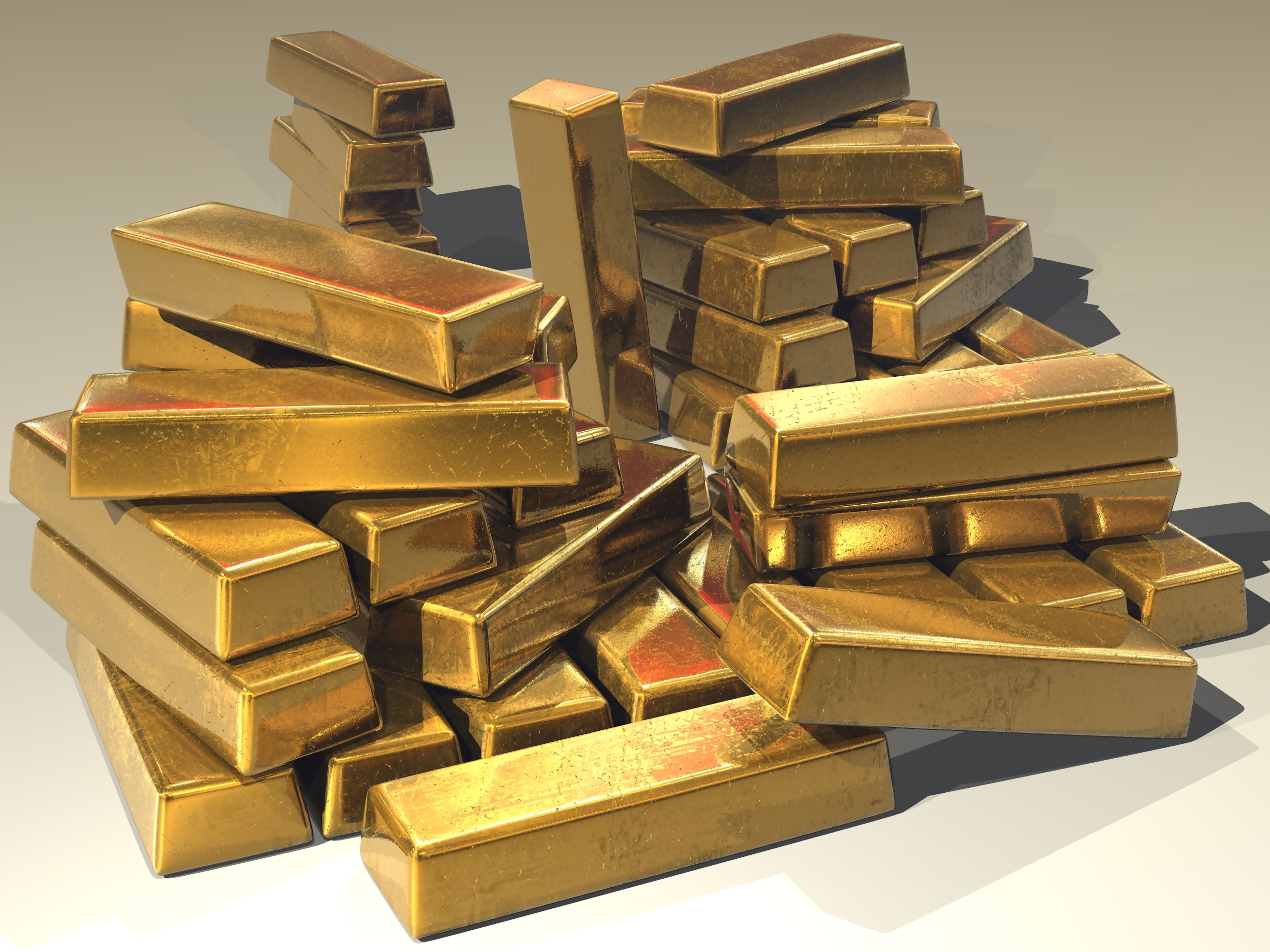 Large pile of gold bars stacked on each other randomly