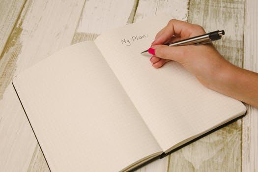 hand pen writing notebook