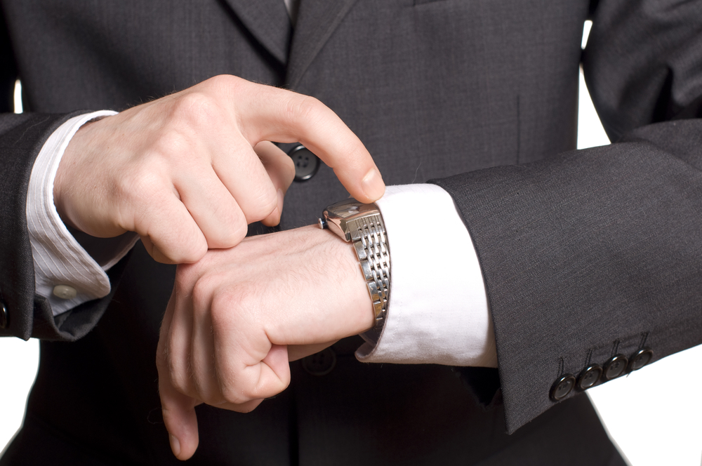 Image of Impatient Business Owner Looking at Watch