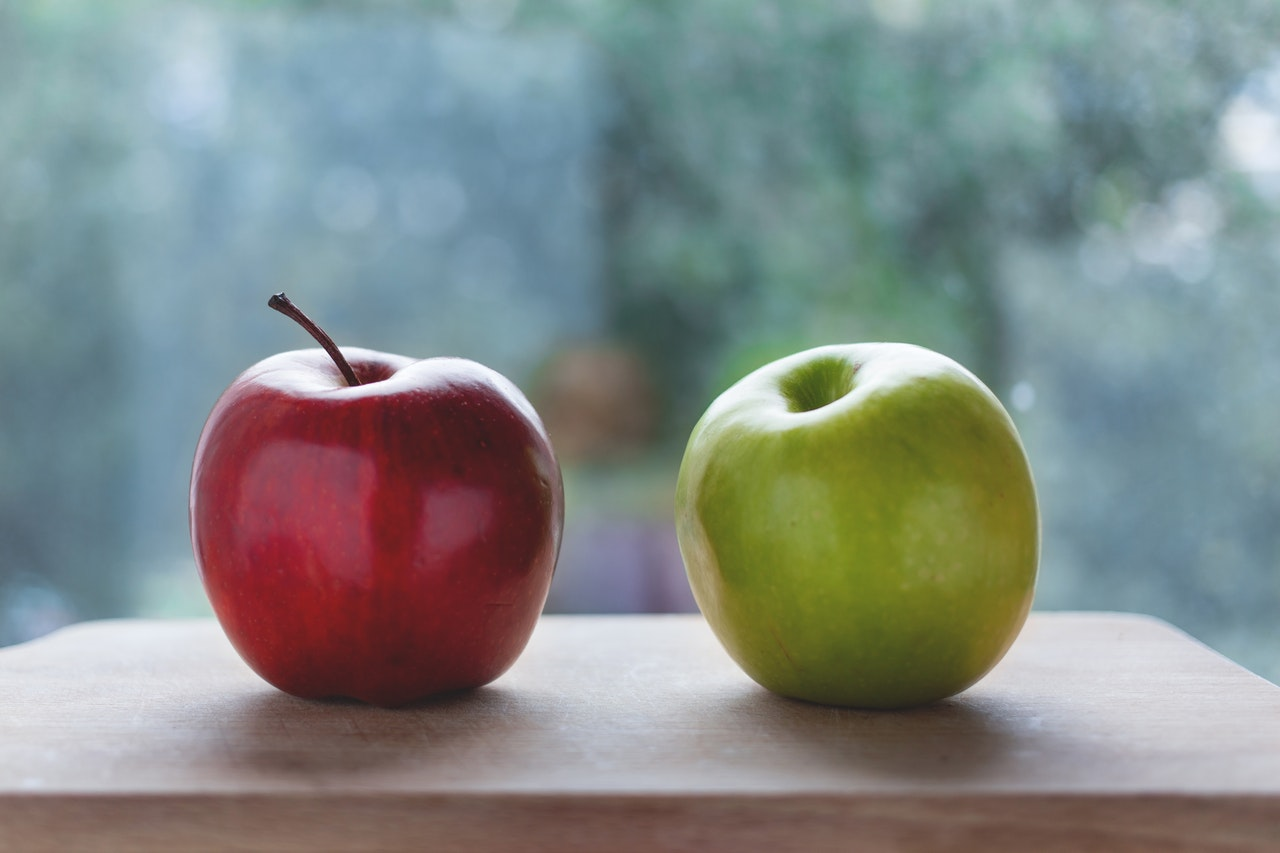 Image Of One Red Apple And One Green Apple On A Table