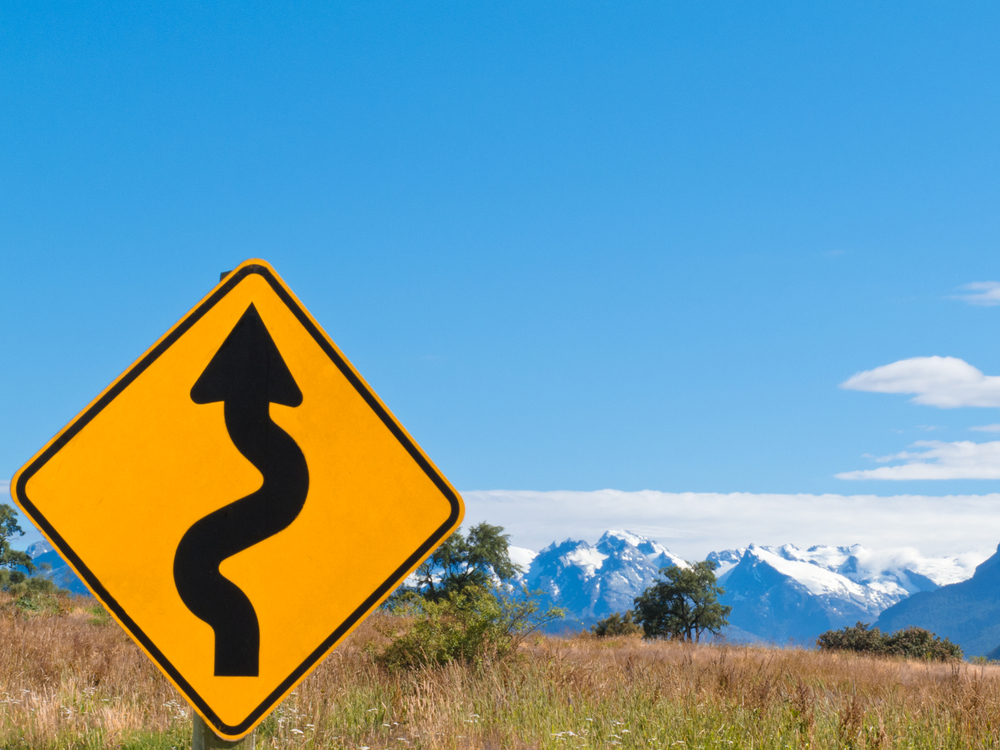 Image of a Road Sign in Front of Mountains