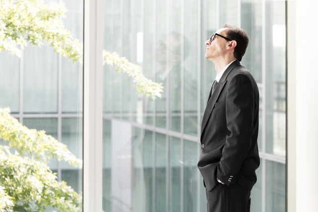 Image of A Business Advisors Looking out a Window
